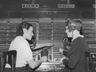 Two Female Switchboard Operators Connecting International Calls