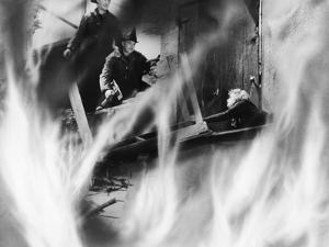 Two Fire Fighters Rescuing a Woman