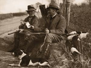 Two Hunters With Dogs Sharing Cigars