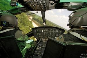 Two Instructor Pilots Practice Low Flying Operations in a Uh-1H Huey Helicopter