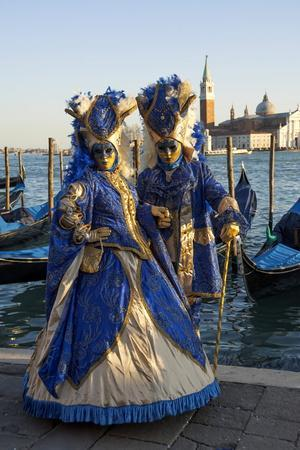 https://imgc.allpostersimages.com/img/posters/two-ladies-in-blue-and-gold-masks-venice-carnival-venice-veneto-italy_u-L-PWFD4I0.jpg?artPerspective=n