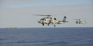 Two Mh-60 Sea Hawk Helicopters During an Air Demonstration