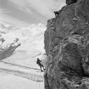 Two Mountain Climbers on the Side of a Mountain in Zermatt, Switzerland, 1954
