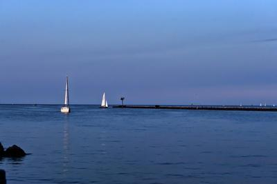 https://imgc.allpostersimages.com/img/posters/two-sailboats-and-pier_u-L-Q1CQJL30.jpg?artPerspective=n