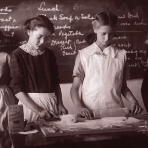 Two School Girls Baking in Home Economics Class