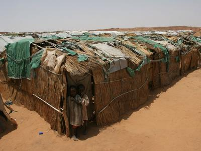 https://imgc.allpostersimages.com/img/posters/two-sudanese-boys-stand-by-makeshift-huts_u-L-Q10ORPL0.jpg?p=0