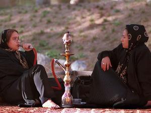 Two Unidentified Iranian Women Smoke a Water Pipe