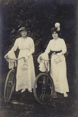 Two Women with Bicycles, Carrying Purses