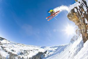 Freestyle Skier Jumping off Cliff by Tyler Stableford