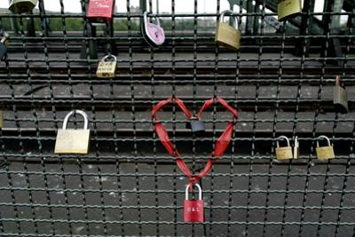 Padlocks Attached to a Fence on the Hohenzollern Railroad Bridge
