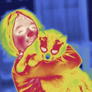 Thermal Image of a 9 Year Old Girl Holding Her Pet Cat by Tyrone Turner