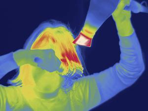 Thermal Image of a Woman Blow Drying Her Hair by Tyrone Turner