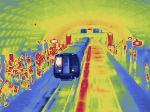 Thermal Image of Passengers Standing on a Platform at a Metro Station and a Departing Train by Tyrone Turner