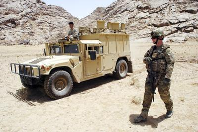 U.S. Air Force Soldier Guides an Afghan Border Police Vehicle