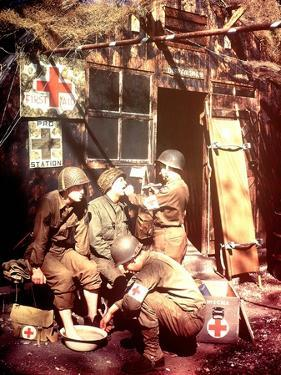 U.S. Army Medics are Treating Two Gis, Southern England, 1944