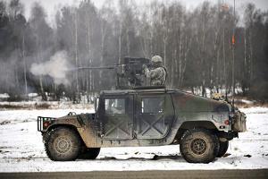 U.S. Army Paratrooper Fires an M2 .50-Caliber Machine Gun Atop a Humvee