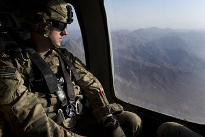 U.S. Army Soldier Looks Out the Window of a Uh-60 Black Hawk Helicopter