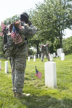 U.S. Army Soldiers Place Flags in Front of the Gravesites in Arlington National Cemetery