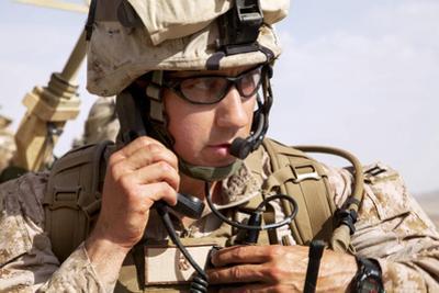U.S. Marine Talks over the Radio in Afghanistan