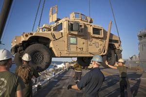 U.S. Marines Guide a Humvee onto USS Bonhomme Richard