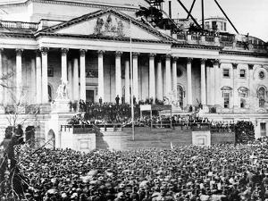 U.S. President Abraham Lincoln Stands Under Cover at Center of Capitol Steps