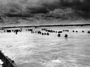 U.S. Reinforcements Wade Through the Surf as They Land at Normandy