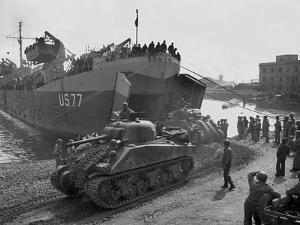 U.S. Sherman Tanks Leave a Landing Ship in Anzio Harbor, May 1944