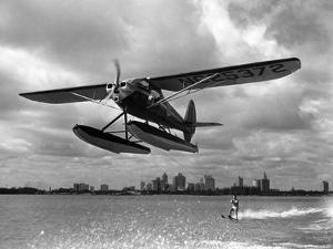 U.S. Water Ski Champion Bruce Parker Being Towed by a Seaplane across Biscayne Bay, 1946