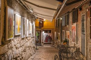 Croatia, Istria, Adriatic Coast, Rovinj, Art Gallery in Old Town Lane in the Evening by Udo Siebig