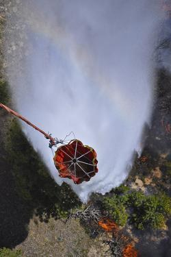 Uh-60 Black Hawk Helicopters Perform Water Drops Using Bambi Buckets