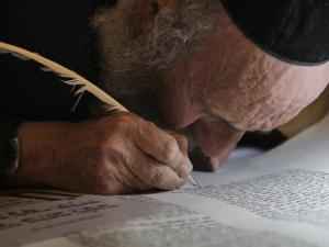 Ultra-Orthodox Jew Writes Some of the Last Words in a Torah Scroll