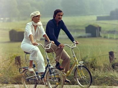 https://imgc.allpostersimages.com/img/posters/un-amour-by-pluie-by-jean-claude-brialy-with-romy-schneider-and-nino-castelnuovo-1973-photo_u-L-Q1C2HL20.jpg?artPerspective=n