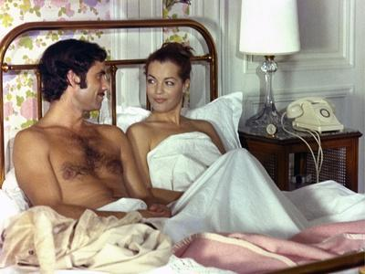 https://imgc.allpostersimages.com/img/posters/un-amour-by-pluie-by-jean-claude-brialy-with-romy-schneider-and-nino-castelnuovo-1973-photo_u-L-Q1C2IBV0.jpg?artPerspective=n