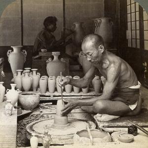 A Potter and His Wheel, Fashioning a Vase of Awata Porcelain, Kinkosan Works, Kyoto, Japan, 1904 by Underwood & Underwood