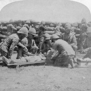 First Aid to a Wounded Fusilier, Honey Nest Kloof Battle, Boer War, South Africa, February 1900 by Underwood & Underwood