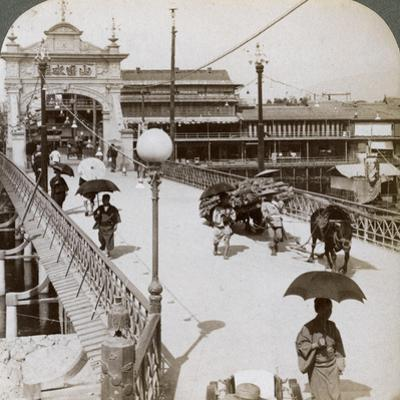 Looking West over the Kamo River (Kamogaw) at Shijo Bridge, Kyoto, Japan, 1904 by Underwood & Underwood
