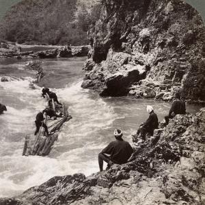 Men on a Log Raft, Shooting the Hozu Rapids on the Katsura River, Kyoto, Japan, 1904 by Underwood & Underwood