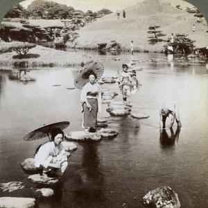 Women Crossing the Lake on Stepping Stones, Suizen-Ji Garden, Kumamoto, Japan, 1904 by Underwood & Underwood