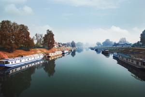 Boats in the River, Jhelum River, Srinagar, Jammu and Kashmir, India by uniquely india
