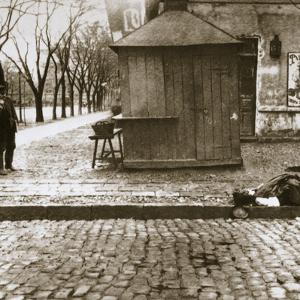 An onlooker observes a dead man left in the streets, Russia, early 20th century by Unknown