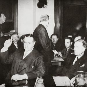 Richard Whitney being sworn in at a public hearing regarding his misappropriation of funds, c1938 by Unknown