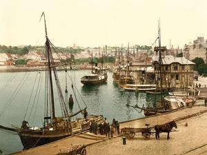 Unloading Cargo at the Quayside with Steamboat Moorings in the Background
