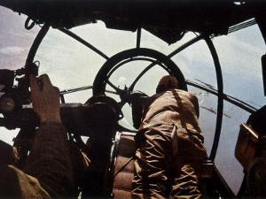 German Machine-Gunner in the Cockpit of a Bomber, Probably a Heinkel He-111 by Unsere Wehrmacht
