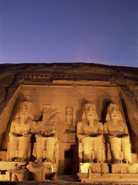 Floodlit Temple Facade and Colossi of Ramses II (Ramesses the Great), Abu Simbel, Nubia, Egypt by Upperhall Ltd