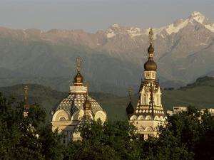 Zenkov Cathedral and Tien Shan Mountains, Almaty, Kazakhstan, Central Asia by Upperhall