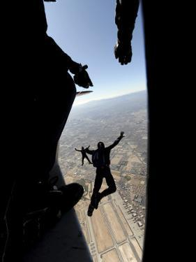 US Air Force Academy Parachute Team Jumps Out of an Aircraft over Nellis Air Force Base, Nevada
