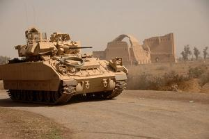 US Bradley Fighting Vehicle Passes by the Palace of Historic Ctesiphon, Feb. 16, 2008