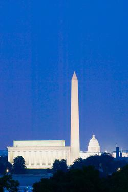 US Capitol, Washington Monument and Lincoln Memorial in Washington D.C. at dusk with blue sky