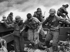 US Coast Guardsmen Assisting a Wounded Marine Returning from the Fight on Iwo Jima