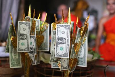 https://imgc.allpostersimages.com/img/posters/us-dollars-on-buddhist-money-tree-to-make-merit-and-donate-to-local-temple-wat-naxai-temple_u-L-Q1GYGX10.jpg?artPerspective=n